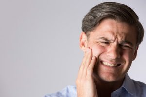 Restless Jaw Syndrome leads to jaw discomfort Copyright: daisydaisy / 123RF Stock Photo