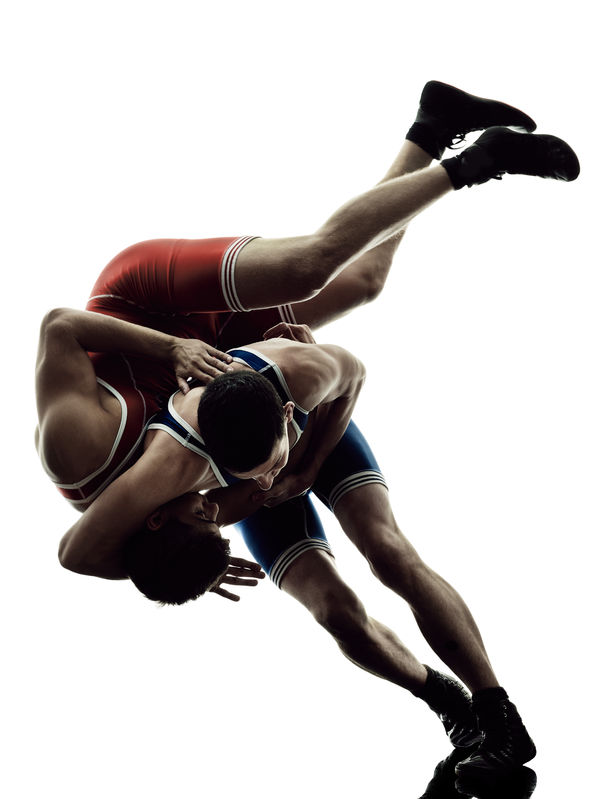 two men competing in a greco-roman wrestling match